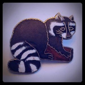Sneaky raccoon hat pin